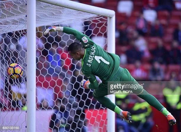 Villarreal's goalkeeper Sergio Asenjo fails tries to stop a goal during the Spanish league football match Real Sporting de Gijon vs Villarreal CF at...