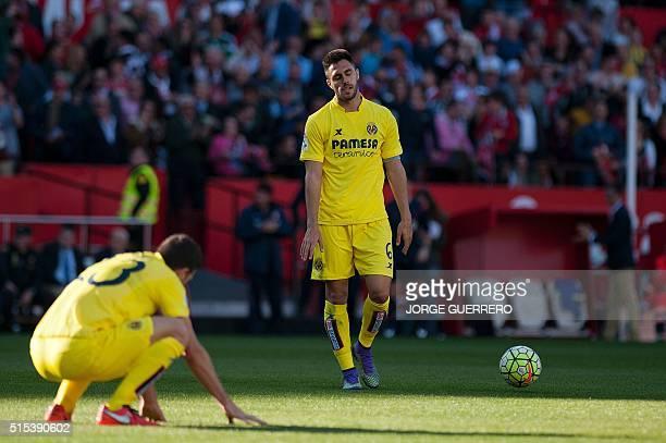 Villarreal's Italian defender Daniele Bonera and Villarreal's defender Victor Ruiz rects after being defeated 42 at the end of the Spanish league...
