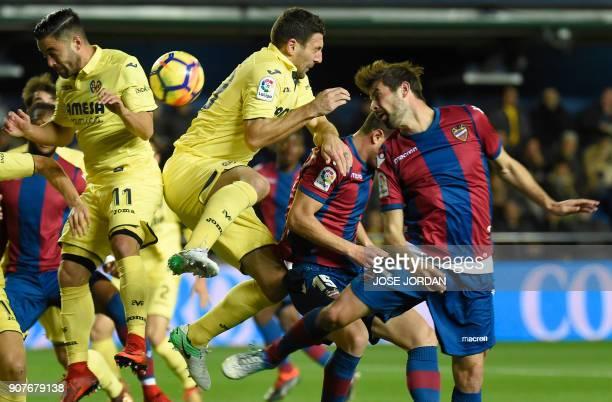 Villarreal's Italian defender Daniele Bonera and Villarreal's defender Jaume Costa vies with Levante's defender Coke during the Spanish league...