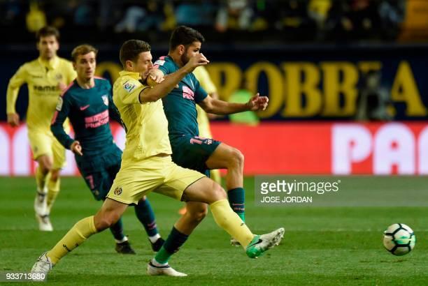 Villarreal's Italian defender Daniele Bonera vies with Atletico Madrid's Spanish forward Diego Costa during the Spanish League football match between...