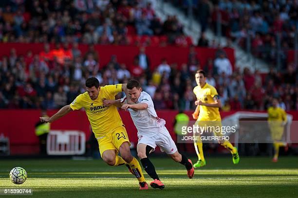 Villarreal's Italian defender Daniele Bonera vies with Sevilla's French forward Kevin Gameiro during the Spanish league football match FC Sevilla vs...