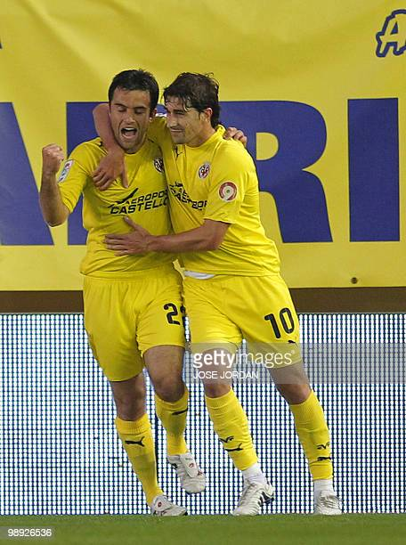 Villarreal's Italian forward Giuseppe Rossi celebrates after scoring a goal with his teammate midfielder Cani during their Spanish league football...