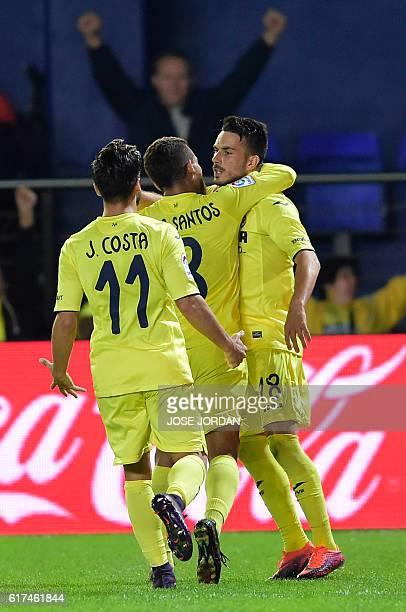 Villarreal's Italian forward Nicola Sansone celebrates a goal with Villarreal's defender Jaume Costa and Villarreal's Mexican midfielder Jonathan dos...