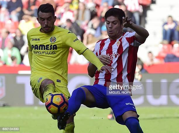 Villarreal's Italian forward Nicola Sansone vies with Sporting Gijon's defender Jorge Mere during the Spanish league football match Real Sporting de...