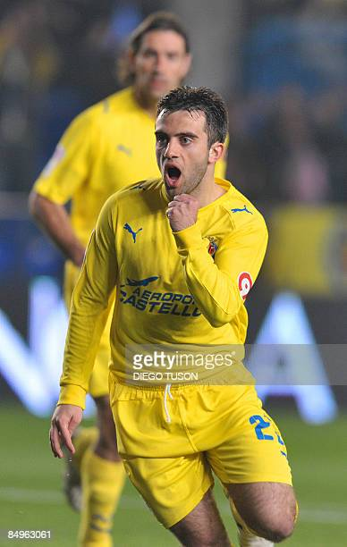 Villarreal's Italian Giuseppe Rossi celebrates after scoring against Sporting Gijon during their Spanish league football match at the Madrigal...