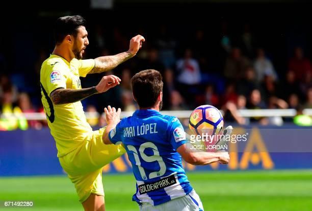 Villarreal's Italian midfielder Roberto Soriano vies with Leganes' midfielder Unai Lopez during the Spanish league football match Villarreal CF vs...