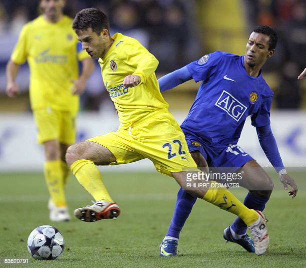Villarreal's Italian player Giuseppe Rossi fights for the ball with Manchester's Portuguese player Nani during their Champions league football match...