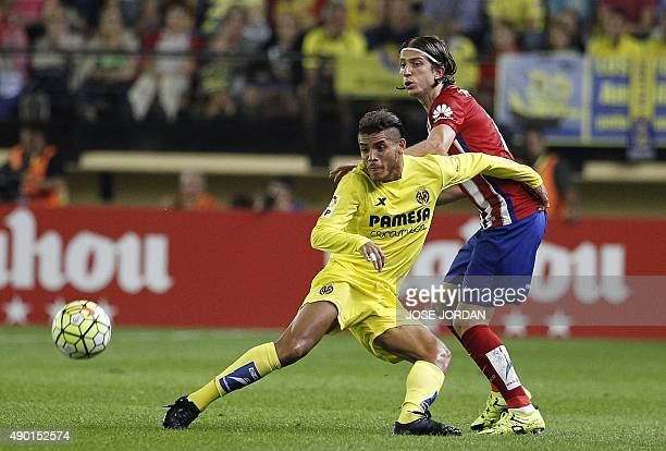 Villarreal's Mexican forward Jhonatan dos Santos vies with Atletico Madrid's Brazilian defender Filipe Luis during the Spanish league football match...