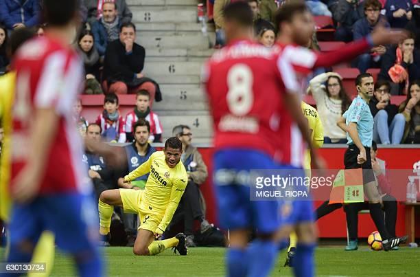 Villarreal's Mexican forward Jonathan dos Santos celebrates after scoring a goal during the Spanish league football match Real Sporting de Gijon vs...