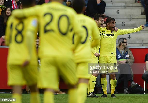 Villarreal's Mexican forward Jonathan dos Santos celebrates with teammates after scoring a goal during the Spanish league football match Real...