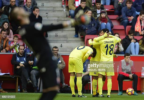 Villarreal's Mexican forward Jonathan dos Santos celebrates with teammates after scoring during the Spanish league football match Real Sporting de...