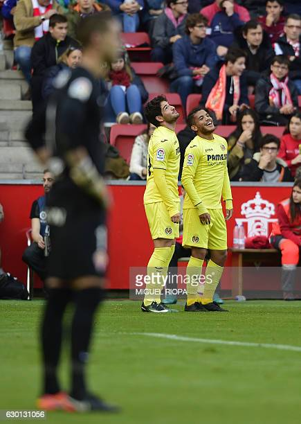 Villarreal's Mexican forward Jonathan dos Santos celebrates with teammate Brazilian forward Alexandre Pato after scoring a goal during the Spanish...