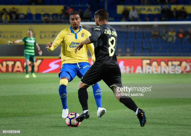 Villarreal's Mexican midfielder Jonathan Dos Santos vies Las Palmas' German midfielder Kevin Prince Boateng during the Spanish league football match...