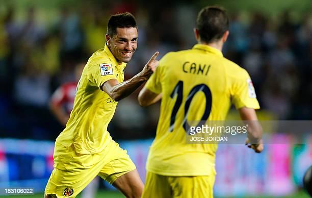 Villarreal's midfielder Bruno Soriano celebrates his goal with Villarreal's midfielder Cani during the Spanish league football match Villarreal CF vs...