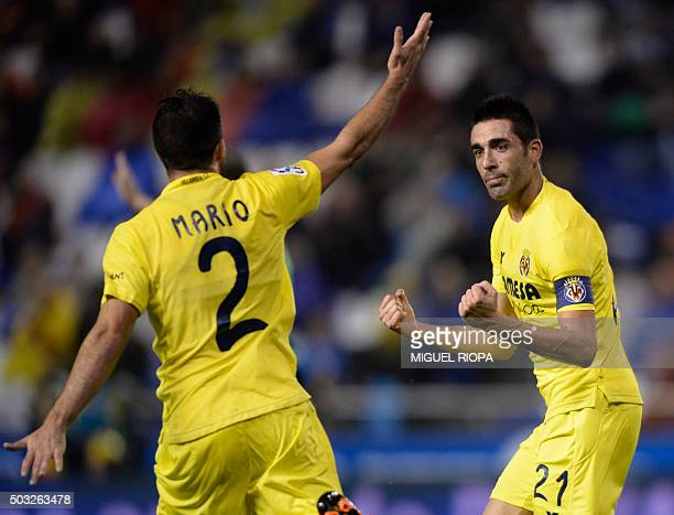 Villarreal's midfielder Bruno Soriano celebrates with a teammate after scoring a goal during the Spanish league football match RC Deportivo de la...