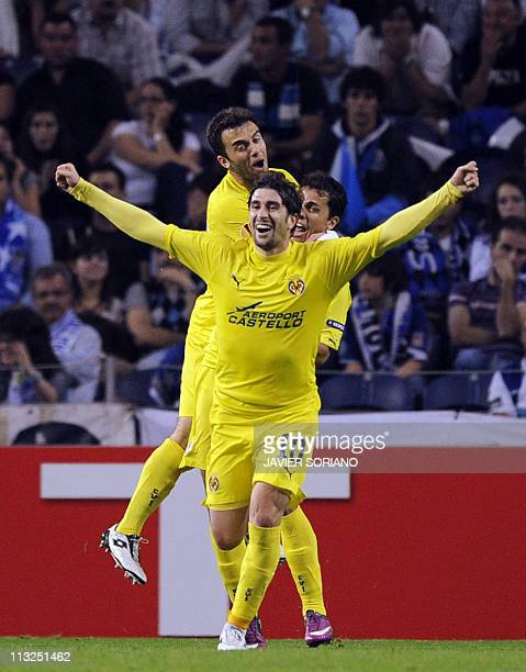 Villarreal's midfielder Cani and teammates celebrate after scoring their first goal during the UEFA Europa League semi-final first leg football match...