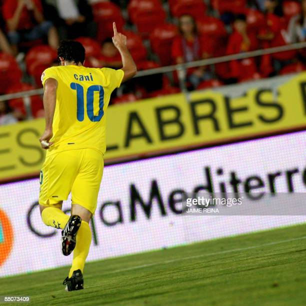 Villarreal's midfielder Cani celebrates after scoring against Mallorca's during the Spanish league football match at the Ono stadium in Palma de...