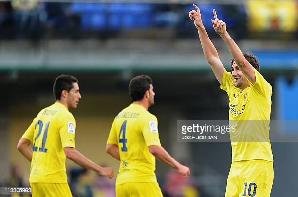 Villarreal's midfielder Cani celebrates after scoring against Getafe during their Spanish league football match on May 1, 2011 at El Madrigal stadium...