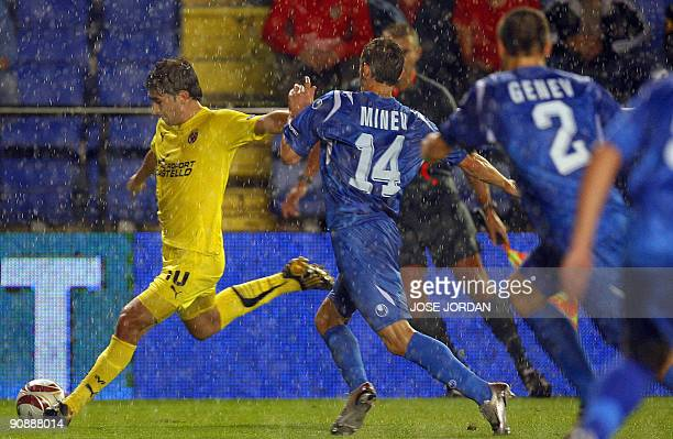 Villarreal's midfielder Cani figths for the ball with Levski´s Veslein MInev and Viktor Genev during their Europe league football match at Madrigal...