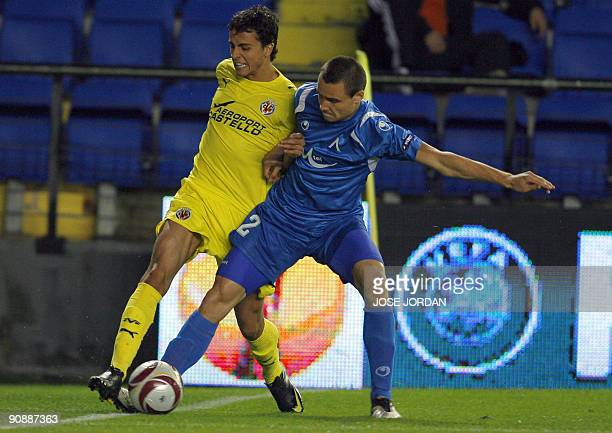 Villarreal's midfielder Cani figths for the ball with Levski´s Viktor Genev during their UEFA Europa league football match at Madrigal Stadium in...