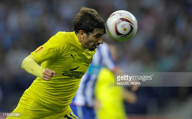 Villarreal's midfielder Cani heads the ball to score a goal against FC Porto during their UEFA Europa League semifinal first-leg football match...