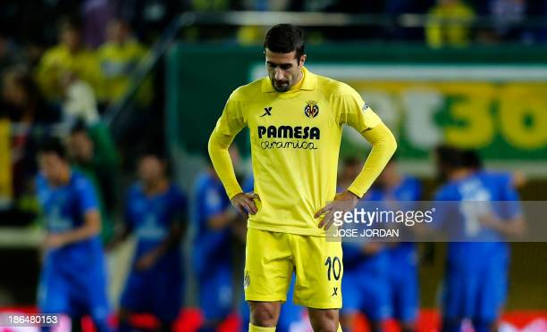 Villarreal's midfielder Cani reacts after Getafe scored during the Spanish league football match Villarreal CF vs Getafe CF at El Madrigal stadium in...