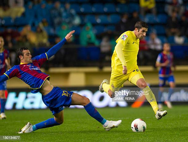 Villarreal's midfielder Cani vies for the ball with Levante's Midfielder Vicente Iborra de la Fuente during the Spanish league football match between...