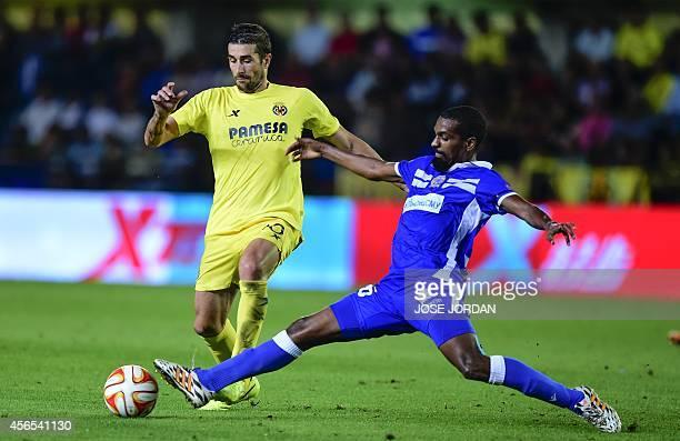 Villarreal's midfielder Cani vies with Apollon Limassol's midfielder from Morocco Rachid Hamdani during the Europa League football match Villarreal...