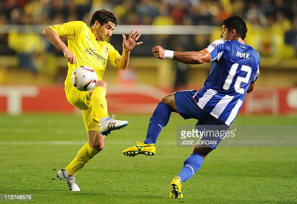 "Villarreal's midfielder Cani vies with FC Porto's Brazilian forward Givanildo de Souza ""Hulk"" during the UEFA Europa League semi-final second leg..."