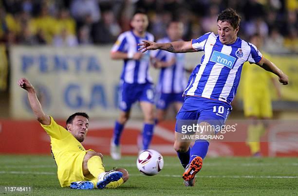 Villarreal's midfielder Cani vies with FC Porto's Uruguayan midfielder Cristian Rodriguez during the UEFA Europa League semi-final second leg...