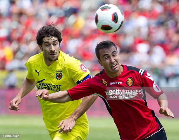 Villarreal's midfielder Cani vies with Mallorca's defender Ayoze Diaz during the Spanish league football match Mallorca vs Villarreal on May 8, 2011...