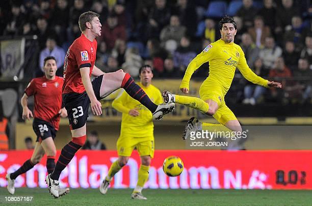 Villarreal's midfielder Cani vies with Osasuna's defender Sergio Fernandez during the Spanish league football match Villarreal CF vs Club Atletico...