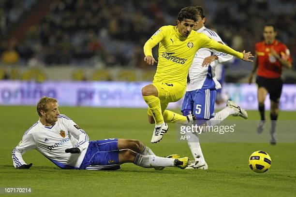 Villarreal's midfielder Cani vies with Zaragoza's Czech defender Jorosik during the Spanish League football match Zaragoza vs Villareal at Romareda...
