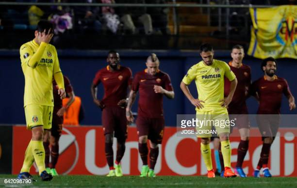 Villarreal's midfielder Manu Trigueros and Villarreal's defender Victor Ruiz gesture after Roma's goal during the Europa League round of 32 first leg...