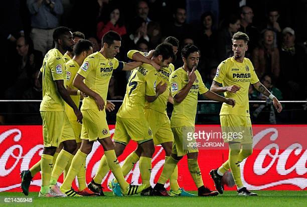 Villarreal's midfielder Manu Trigueros celebrates with teammates after scoring during the Spanish league football match Villarreal CF vs Real Betis...