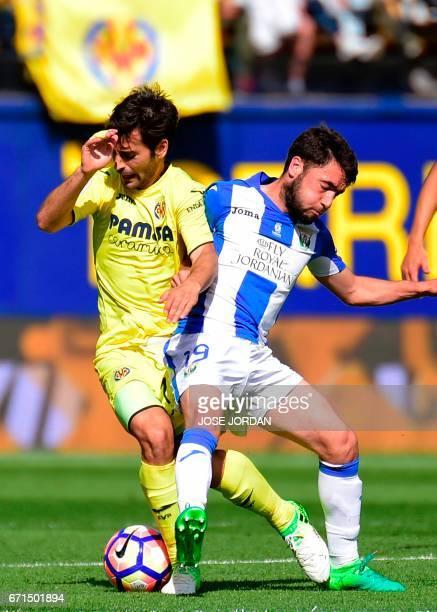 Villarreal's midfielder Manu Trigueros vies with Leganes' midfielder Unai Lopez during the Spanish league football match Villarreal CF vs Club...