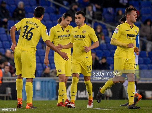 Villarreal's midfielder Rodrigo Hernandez is congratulated by teammate Villarreal's midfielder Javi Fuego for scoring a goal during the Spanish...