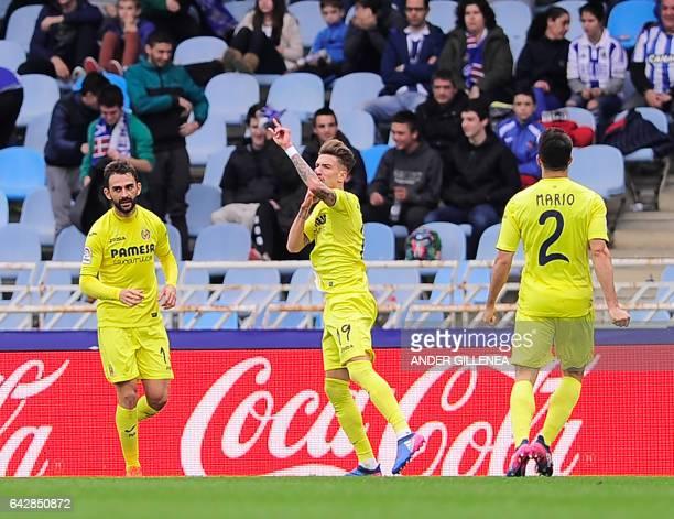 Villarreal's midfielder Samuel Castillejo celebrates with Slovenian defender Bojan Jokic and Villarreal's defender Mario Gaspar Perez Martinez after...