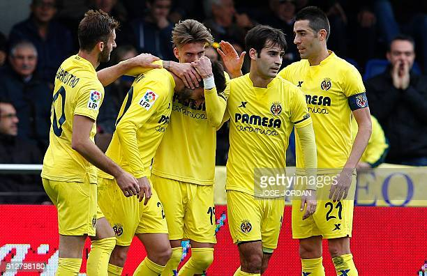 Villarreal's midfielder Samuel Castillejo celebrates with teammates after scoring during the Spanish league football match Villarreal CF vs Levante...