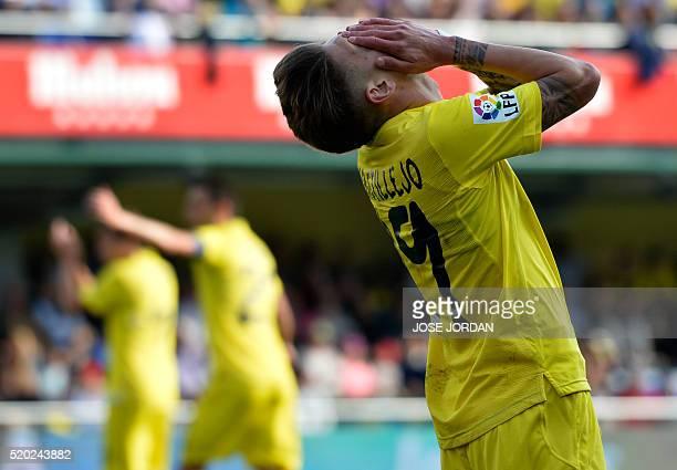Villarreal's midfielder Samuel Castillejo reacts after missing an attempt on goal during the Spanish league football match Villarreal CF vs Getafe CF...