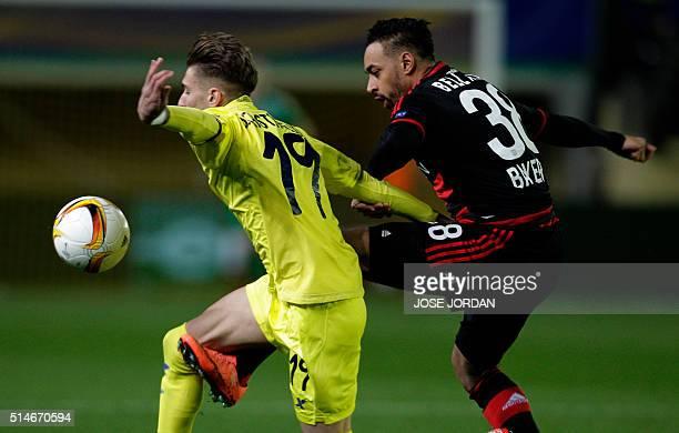 Villarreal's midfielder Samuel Castillejo vies with Leverkusen's midfielder Karim Bellarabi during the UEFA Europa League Round of 16 first leg...