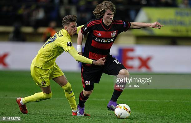 Villarreal's midfielder Samuel Castillejo vies with Leverkusen's Croatian defender Tin Jedvaj during the UEFA Europa League Round of 16 first leg...