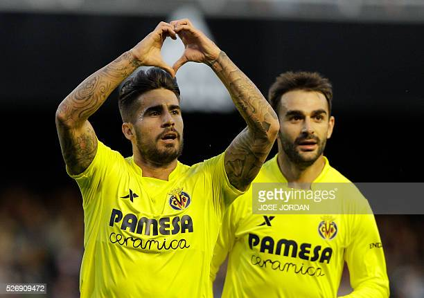 Villarreal's midfielder Samuel Garcia celebrates past Villarreal's forward Adrian Lopez after scoring during the Spanish league football match...