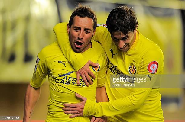 Villarreal's midfielder Santi Cazorla celebrates his goal with Villarreal's midfielder Cani during the Spanish league football match Villareal CF vs...
