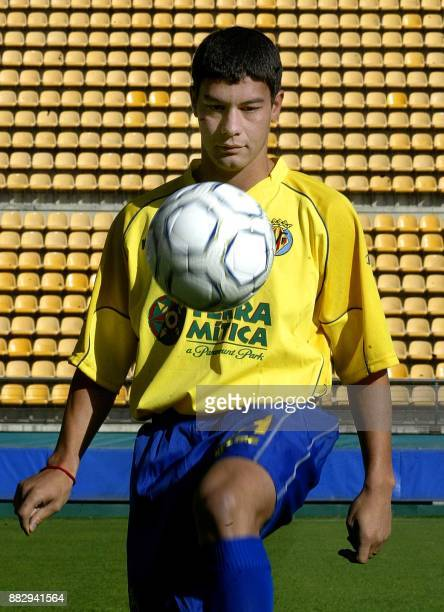 Villarreal's new Argentine international midfielder Sebastian Alejandro Battaglia plays with the ball during his official presentation at the...