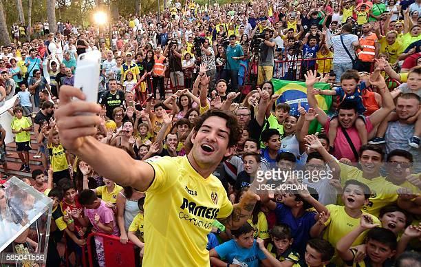 Villarreal's new signing Brazilian Alexandre Rodrigues da Silva Pato takes selfies with fans during his Official presentation at Ermita de la Mare de...
