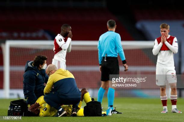 Villarreal's Nigerian midfielder Samu Chukwueze receives medical attention after appearing to pick up an injury during the UEFA Europa League...