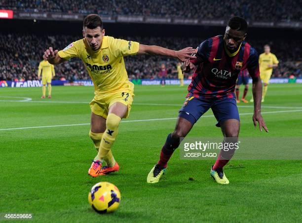 Villarreal's Paraguayan midfielder Hernan Arsenio Perez vies with Barcelona's Cameroonian midfielder Alexandre Song during the Spanish league...