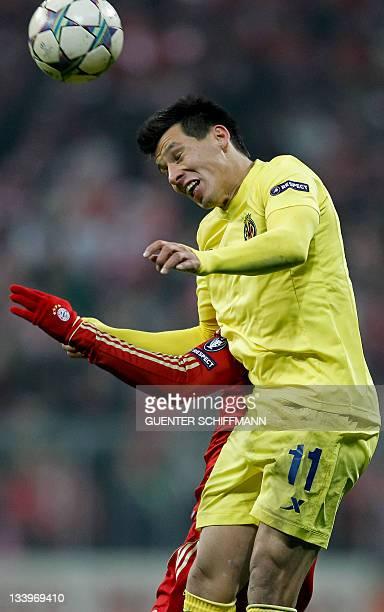 Villarreal's Paraguayan midfielder Hernan Perez plays the ball during the UEFA Champions League Group A football match between FC Bayern Muenchen vs...