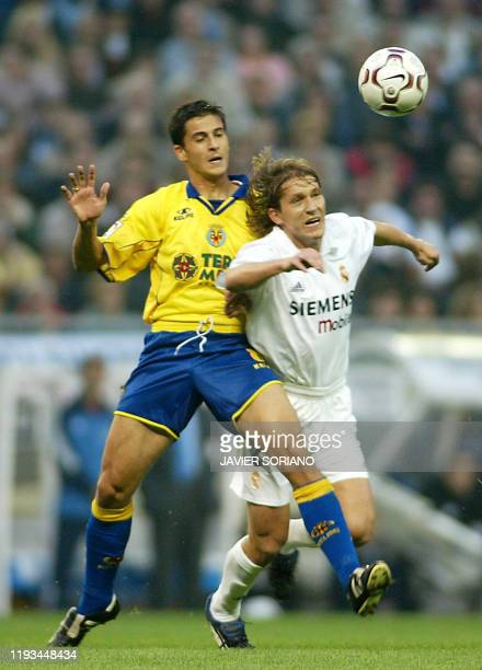 Villarreal's player Jorge Lopez battles for the ball with Real Madrid's player Michel Salgado during their Spanish League match Real Madrid against...